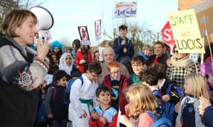 Campaigners in Barnet, London, protest against cuts to libraries.