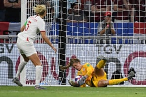United States' goalkeeper Alyssa Naeher saves a penalty kick from Steph Houghton.