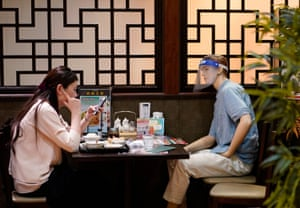 Tokyo, Japan A customer sits opposite a mannequin used to maintain physical distancing at a Chinese restaurant in Tokyo