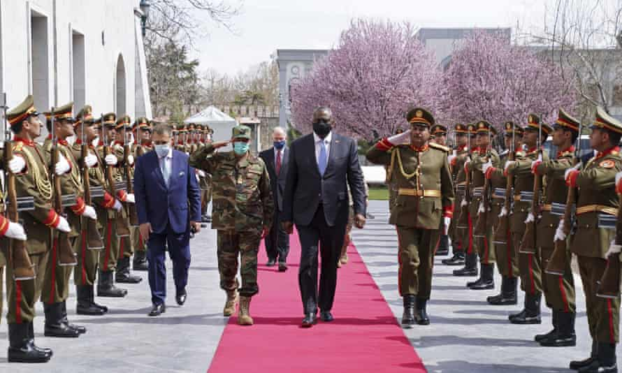US defense secretary Lloyd Austin center, reviews an honor guard at the presidential palace in Kabul, Afghanistan, on Sunday.