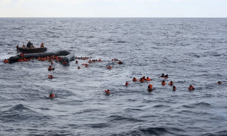 Refugees and migrants being rescued by members of Open Arms.