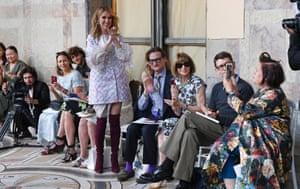 Celine Dion applauds the Giambattista Valli show.
