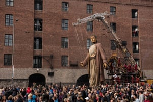 A huge puppet named Giant walks past the dockside in Royal de Luxe's production Liverpool's Dream.