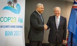 Frank Bainimarama, prime minister of Fiji and host of the Bonn talks, meets with Ambassador Aziz Mekouar of Morrocco