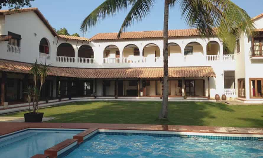 The pool, palm tree and Spanish-style villa of Casa Titik, Cherating, Malaysia.