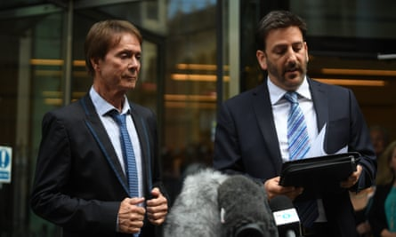 Cliff Richard looks on as his lawyer, Gideon Benaim, reads a statement following the singer's victory in the high court.