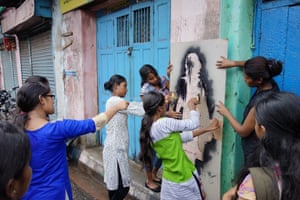 """The project began in mid-June, and already the black silhouettes can be spotted in more than 150 urban locations throughout India with more being painted everyday. The majority of these are in Kolkata, where one of <a href=""""http://www.theguardian.com/global-development/gallery/2012/jul/25/sex-workers-rights-aids-kolkata-in-pictures"""">Asia's largest red light</a> districts is located."""