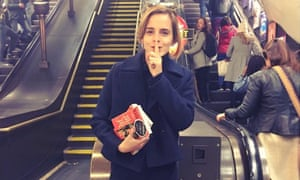 Emma Watson distributing free copies of Maya Angelou's memoir on the London Underground.