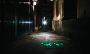 A cyclist in the dark, with a laserlight