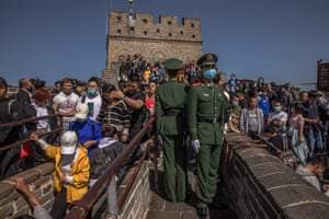 Beijing, China Soldiers stand guard as tourists visit Badaling Great Wall on National Day, marking the 71st anniversary of the founding of the People's Republic of China