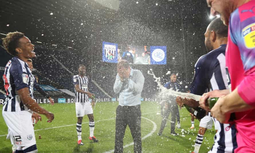 Slaven Bilic is soaked in champagne after West Brom's promotion is confirmed.