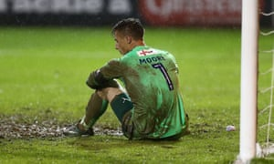 Luton goalkeeper Stuart Moore is inconsolable after his last-gasp own goal handed Blackpool a place in the play-off final.