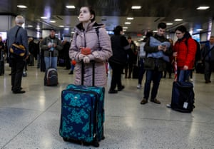 Passengers wait in line to board Amtrak trains ahead of the Thanksgiving Day holiday, at Pennsylvania Station in New York City