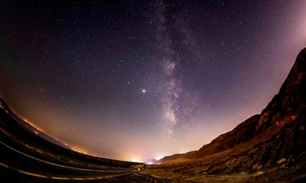 Long-exposure picture taken early with a fish-eye lens early on August 20, 2020 shows a view of the Milky Way galaxy rising in the sky above the Judaean mountains.