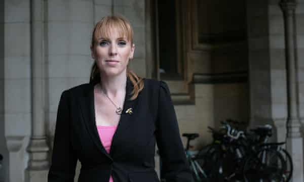 Angela Rayner pictured in front of dark stone building.