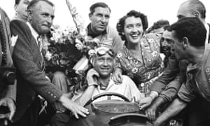 Juan Manuel Fangio is surrounded by a crowd after winning the Grand Prix of Europe in Rheims, France.