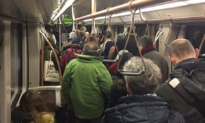 Passengers leaving a metro train between the Arts-Lois and Maelbeek metro stations after an explosion at Maelbeek station