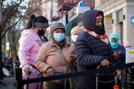 People line up to receive free holiday boxes of food from the Food Bank For New York City ahead of the Thanksgiving holiday, as the global outbreak of the coronavirus disease (COVID-19) continues, in the Harlem neighborhood of New York, US.