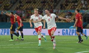 Robert Lewandowski celebrates scoring Poland's equaliser with Karol Swiderski.
