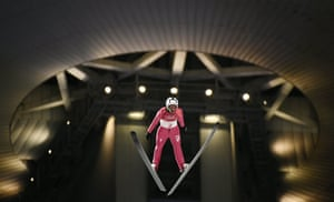 Italy's Federico Cecon competes in the men's normal hill ski jumping trial.
