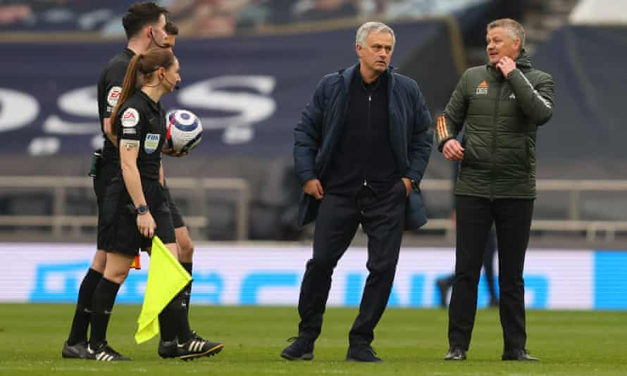 José Mourinho and Ole Gunnar Solskjær with the match officials after Manchester United's 3-1 win at Tottenham.