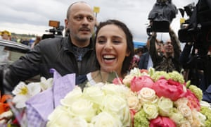 Jamala with bunches flowers