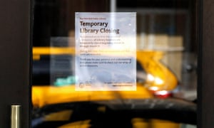 A 'temporary closing notice' posted on the Columbus Library on Tenth Avenue in New York, New York.