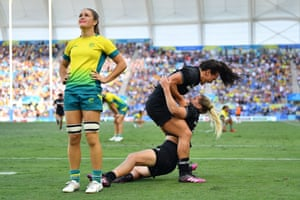 New Zealand's Kelly Brazier is congratulated by Portia Woodman after scoring the winning try in the women's gold medal rugby sevens final against Australia