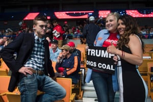 People pose for a photo as they arrive for a rally for Donald Trump in Charleston, West Virginia.