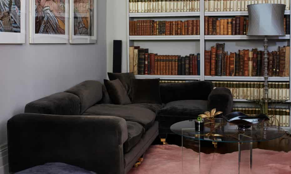 Shelf life: rare books and modern furniture in the sitting room.