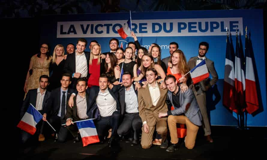 Rassemblement National frontrunner candidate for the European elections Jordan Bardella, centre, celebrates with supporters in Paris.