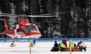 Medics prepare to take George Baker to hospital by helicopter after his fall at St Moritz's White Turf meeting.