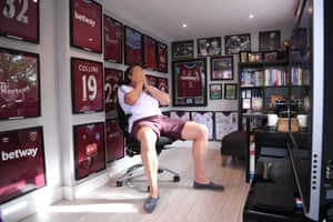 West Ham United superfan Marcus Johns doesn't look impressed with watch he's seeing as he watches the match at home.