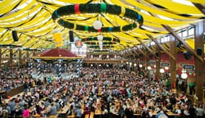 Members of the traditional Bavarian costume associations (Trachtenverein) retire to one of the beer tents