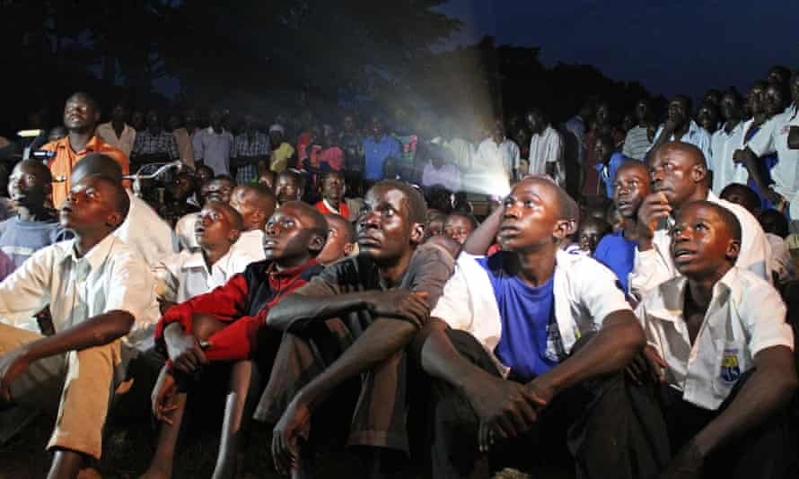 Ugandans watch a screening of Kony 2012