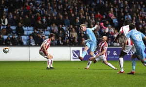 Jack Grimmer, centre, scores Coventry City's second goal against Stoke City in the FA Cup third round.