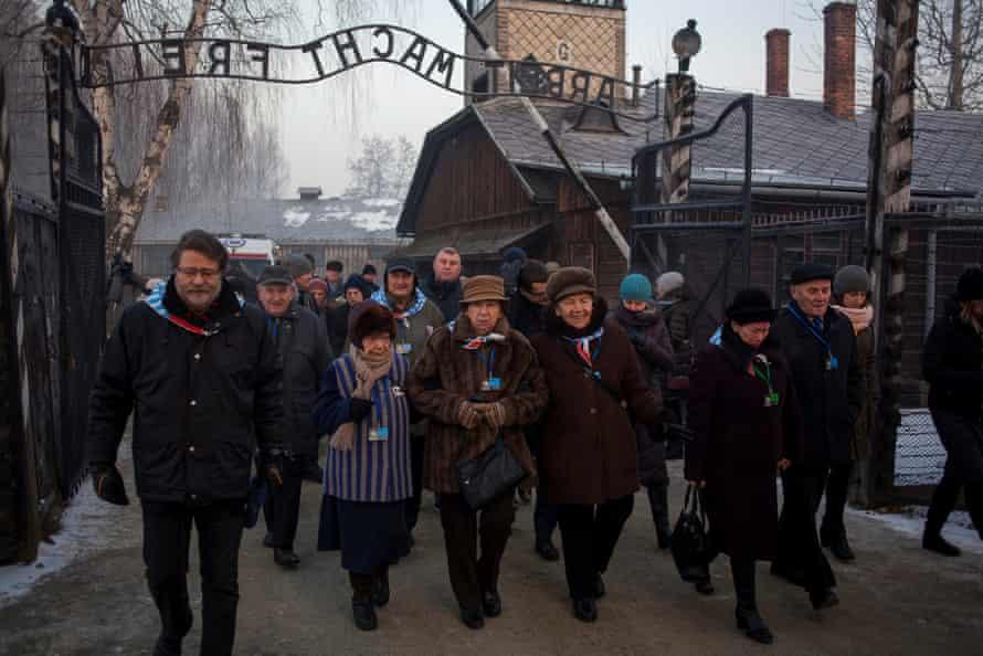 Survivors walk in the former Nazi German concentration and extermination camp Auschwitz-Birkenau