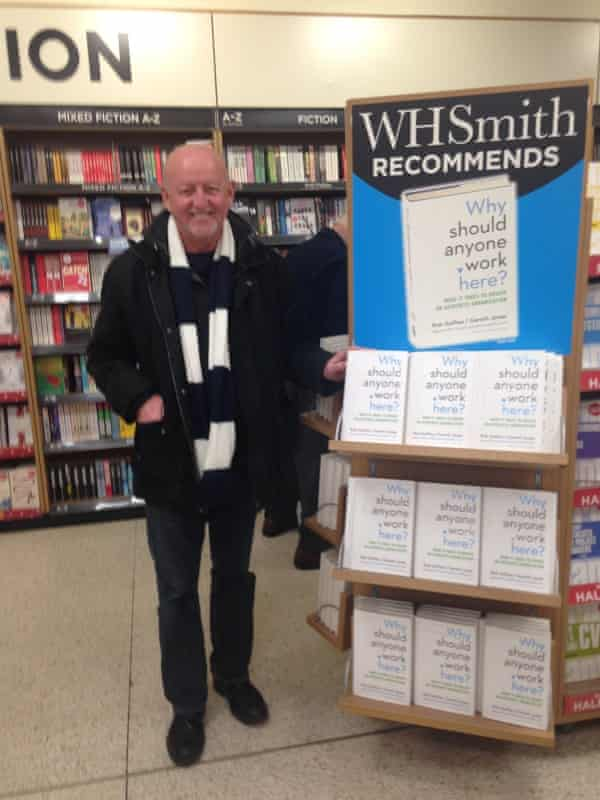 Gareth Jones next to a stand full of one of his books, which he stumbled across on the way to a Spurs game in 2015