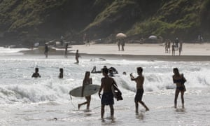 Crowds on Wategos Beach in Byron Bay on 22 March.