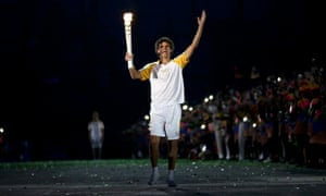 Torch bearer Gustavo Kuerten arrives at the stadium during the opening ceremony.