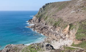 The sea and the cliff rocks at Cot Valley Porth Nanven near St Just West Cornwall England UK