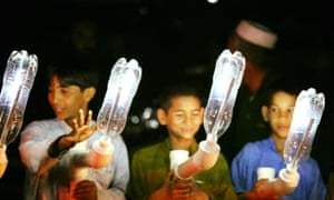 Boys with solar lights made from bottles