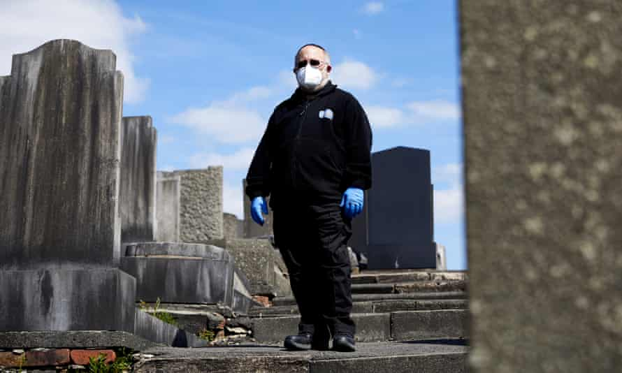 Volunteer Dan Smith at Rainsough cemetery, in north Manchester.
