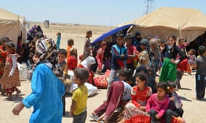 Civilians who fled their homes gather on the outskirts of Falluja last week
