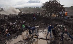 Relatives and volunteers work search for missing villagers after eruptions from Fuego volcano on 17 June. Thousands remain in emergency shelters.