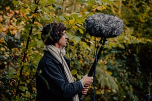 Cosmo Sheldrake listens to dawn bird songs through his recording equipment, in the woods near the cottage in Fordingbridge, Hampshire.