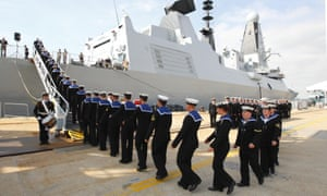 The crew of the Type 45 Destroyer HMS Dragon, march aboard as she is handed over to the Royal Navy. HMS Dragon, is at risk of breakdown in water 'warmer than in Portsmouth harbour'.