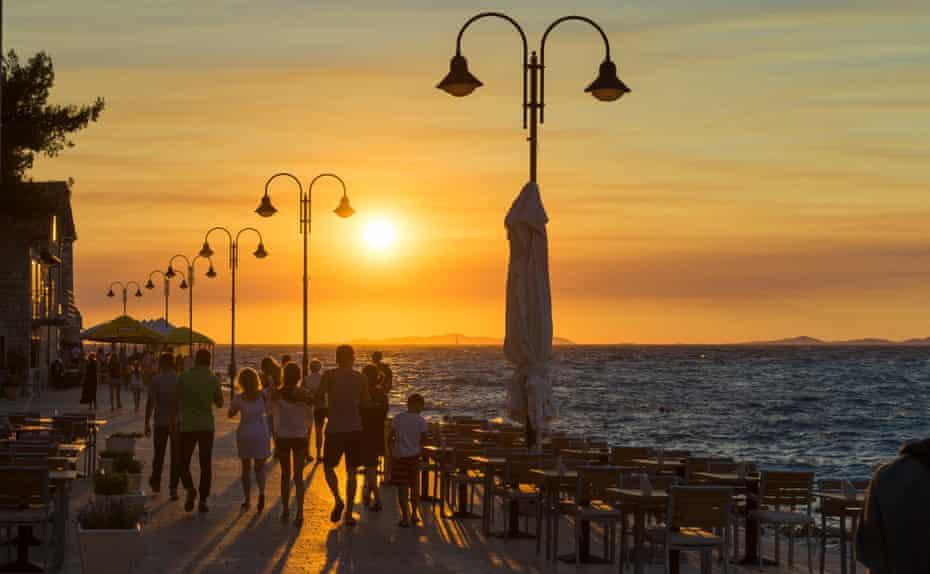 A sunset promenade on the Primošten's Adriatic coast.