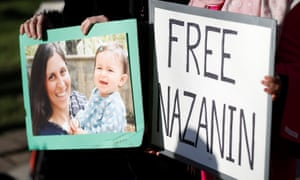 Demonstrators hold placards before a march in support of Nazanin Zaghari-Ratcliffe in London, November 2017.