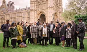 People affected by Windrush scandal standing outside Parliament